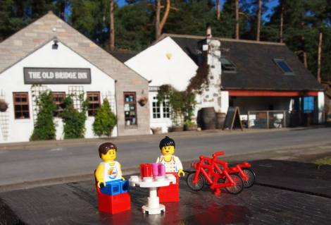 Having a hot drink outside the Old Bridge Inn at Aviemore before heading off on a cycle