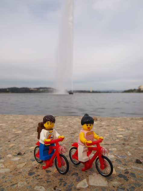 Cycling past Lake Burley Griffin and the Captain James Cook memorial fountain